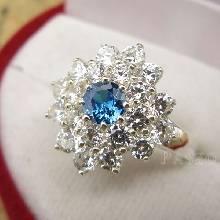 แหวนพลอยบลูโทพาซ สีฟ้าเข้ม ล้อมรอบด้วยเพชร ตัวแหวนเงินแท้ fashion jewelry